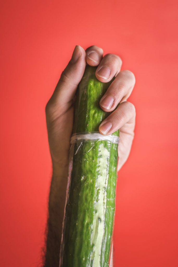 A cucumber and a hand on it - Penis Enlargement Surgery