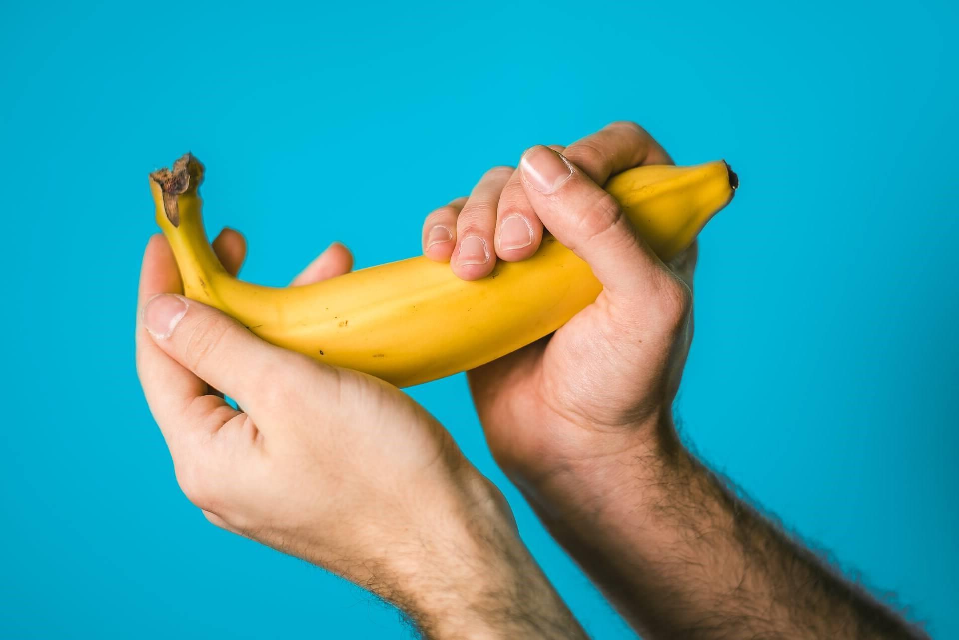 Man Holding Banana Referring to Penis Size